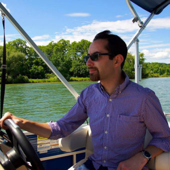 Kevin driving a boat